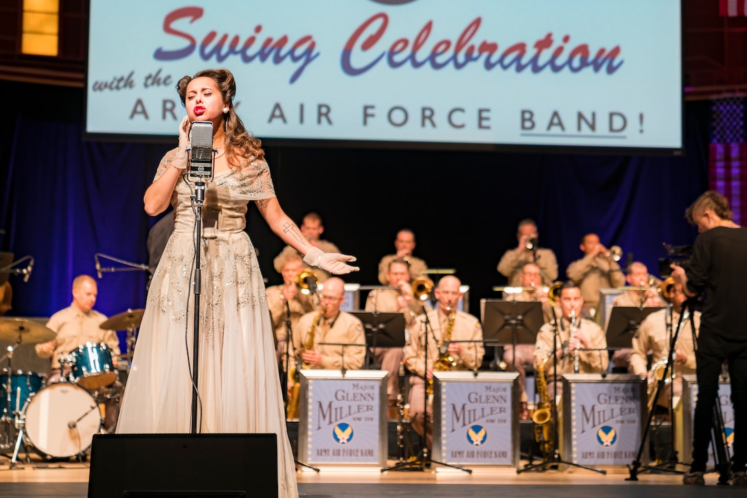"Acclaimed jazz vocalist Veronica Swift sings during ""On the Air: A Glenn Miller Swing Celebration,"" a show featuring The U.S. Air Force Band performing the music of big band legend Major Glenn Miller on April 2, 2019, at the Music Center at Strathmore in North Bethesda, Maryland. The U.S. Air Force Band partnered with Washington Performing Arts to present this concert highlighting the legacy of Major Miller's music and his leadership of the Army Air Force Band. This year marks the 75th anniversary of the disappearance of Miller's plane during World War II. (U.S. Air Force Photo by Master Sgt. Josh Kowalsky)"