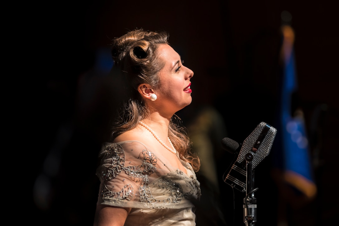 """Acclaimed jazz vocalist Veronica Swift sings during """"On the Air: A Glenn Miller Swing Celebration,"""" a show featuring The U.S. Air Force Band performing the music of big band legend Major Glenn Miller on April 2, 2019, at the Music Center at Strathmore in North Bethesda, Maryland. The U.S. Air Force Band partnered with Washington Performing Arts to present this concert highlighting the legacy of Major Miller's music and his leadership of the Army Air Force Band. This year marks the 75th anniversary of the disappearance of Miller's plane during World War II. (U.S. Air Force Photo by Master Sgt. Josh Kowalsky)"""