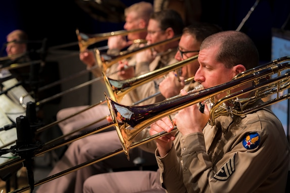 "The trombone section performs during ""On the Air: A Glenn Miller Swing Celebration,"" a show featuring The U.S. Air Force Band performing the music of big band legend Major Glenn Miller on April 2, 2019, at the Music Center at Strathmore in North Bethesda, Maryland. The U.S. Air Force Band partnered with Washington Performing Arts to present this concert highlighting the legacy of Major Miller's music and his leadership of the Army Air Force Band. This year marks the 75th anniversary of the disappearance of Miller's plane during World War II. (U.S. Air Force Photo by Master Sgt. Josh Kowalsky)"