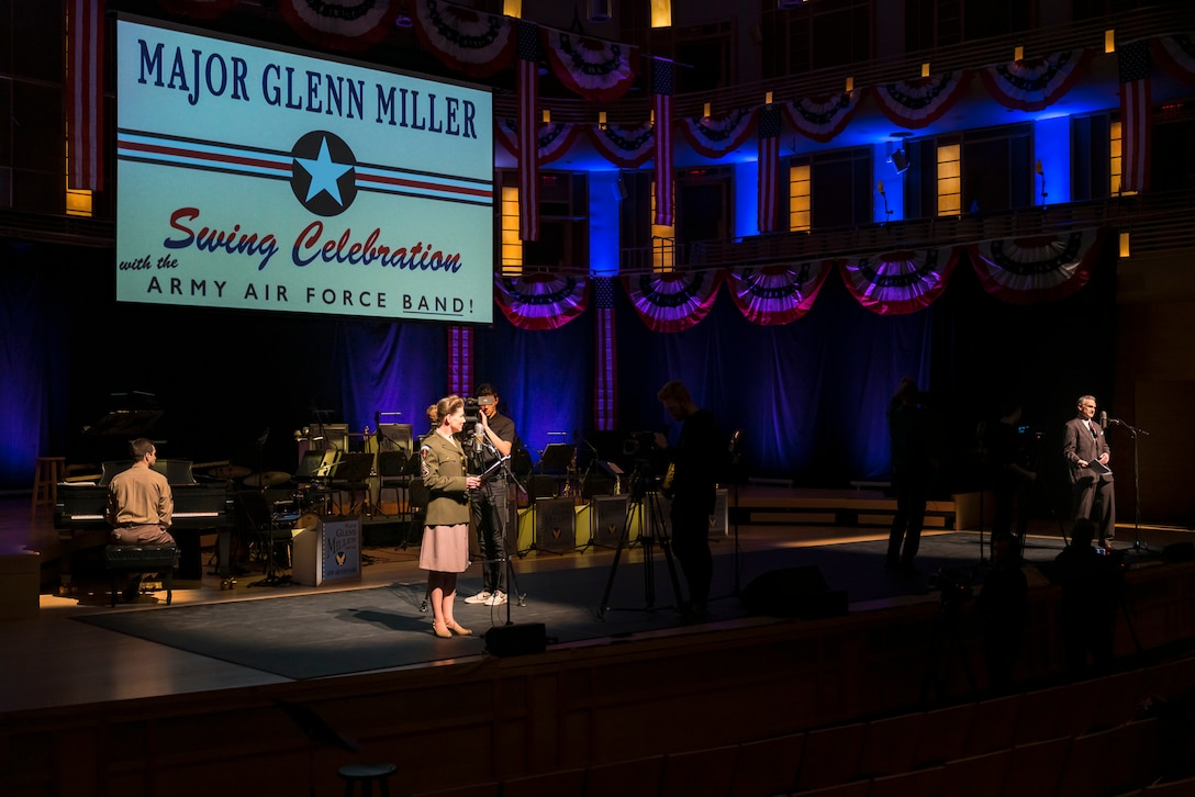 Washington Performing Arts Artist-in-Residence (and host of WAMU's The Big Broadcast) Murray Horwitz (right) serves as emcee as Master Sgt. Brooke Emory (left) waits for the next cue during The U.S. Air Force Band's concert featuring the music of big band legend Major Glenn Miller on April 2, 2019, at the Music Center at Strathmore in North Bethesda, Maryland. The U.S. Air Force Band partnered with Washington Performing Arts to present this concert highlighting the legacy of Major Miller's music and his leadership of the Army Air Force Band. This year marks the 75th anniversary of the disappearance of Miller's plane during World War II. (U.S. Air Force Photo by Master Sgt. Josh Kowalsky)
