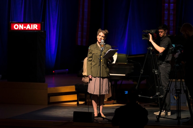 "Master Sgt. Brooke Emory speaks to the audience at ""On the Air: A Glenn Miller Swing Celebration,"" a show that featured The U.S. Air Force Band performing the music of big band legend Major Glenn Miller on April 2, 2019, at the Music Center at Strathmore in North Bethesda, Maryland. The U.S. Air Force Band partnered with Washington Performing Arts to present this concert highlighting the legacy of Major Miller's music and his leadership of the Army Air Force Band. This year marks the 75th anniversary of the disappearance of Miller's plane during World War II. (U.S. Air Force Photo by Master Sgt. Josh Kowalsky)"