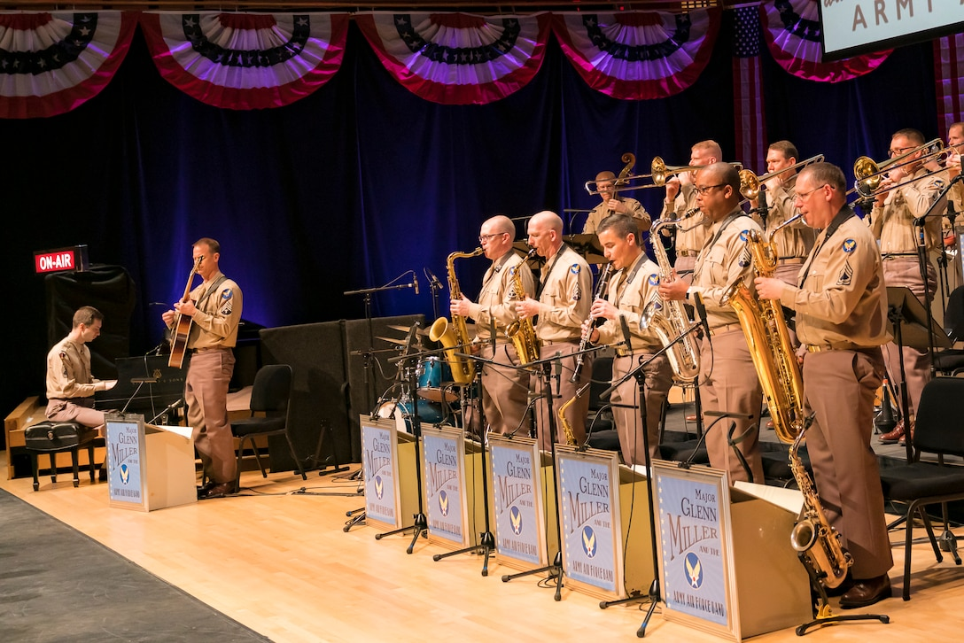 "Members of The U.S. Air Force Band stand to perform the music of big band legend Major Glenn Miller at ""On the Air: A Glenn Miller Swing Celebration,"" on April 2, 2019, at the Music Center at Strathmore in North Bethesda, Maryland. The U.S. Air Force Band partnered with Washington Performing Arts to present this concert highlighting the legacy of Major Miller's music and his leadership of the Army Air Force Band. This year marks the 75th anniversary of the disappearance of Miller's plane during World War II. (U.S. Air Force Photo by Master Sgt. Josh Kowalsky)"
