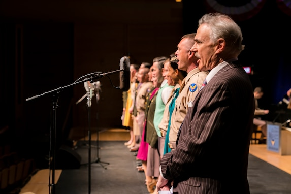 "Washington Performing Arts Artist-in-Residence (and host of WAMU's The Big Broadcast) Murray Horwitz (right) sings along with the entire cast of ""On the Air: A Glenn Miller Swing Celebration,"" a show featuring The U.S. Air Force Band performing the music of big band legend Major Glenn Miller on April 2, 2019, at the Music Center at Strathmore in North Bethesda, Maryland. The U.S. Air Force Band partnered with Washington Performing Arts to present this concert highlighting the legacy of Major Miller's music and his leadership of the Army Air Force Band. This year marks the 75th anniversary of the disappearance of Miller's plane during World War II. (U.S. Air Force Photo by Master Sgt. Josh Kowalsky)"