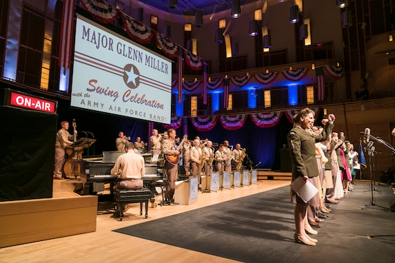 "The entire cast comes onstage for the finale of ""On the Air: A Glenn Miller Swing Celebration,"" a show that featured The U.S. Air Force Band performing the music of big band legend Major Glenn Miller on April 2, 2019, at the Music Center at Strathmore in North Bethesda, Maryland. The U.S. Air Force Band partnered with Washington Performing Arts to present this concert highlighting the legacy of Major Miller's music and his leadership of the Army Air Force Band. This year marks the 75th anniversary of the disappearance of Miller's plane during World War II. (U.S. Air Force Photo by Master Sgt. Josh Kowalsky)"