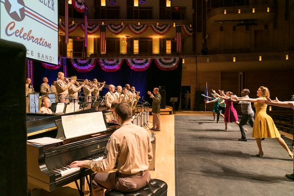 Members of The U.S. Air Force Band perform the music of big band legend Major Glenn Miller as dancers take center stage on April 2, 2019, at the Music Center at Strathmore in North Bethesda, Maryland. The U.S. Air Force Band partnered with Washington Performing Arts to present this concert highlighting the legacy of Major Miller's music and his leadership of the Army Air Force Band. This year marks the 75th anniversary of the disappearance of Miller's plane during World War II. (U.S. Air Force Photo by Master Sgt. Josh Kowalsky)