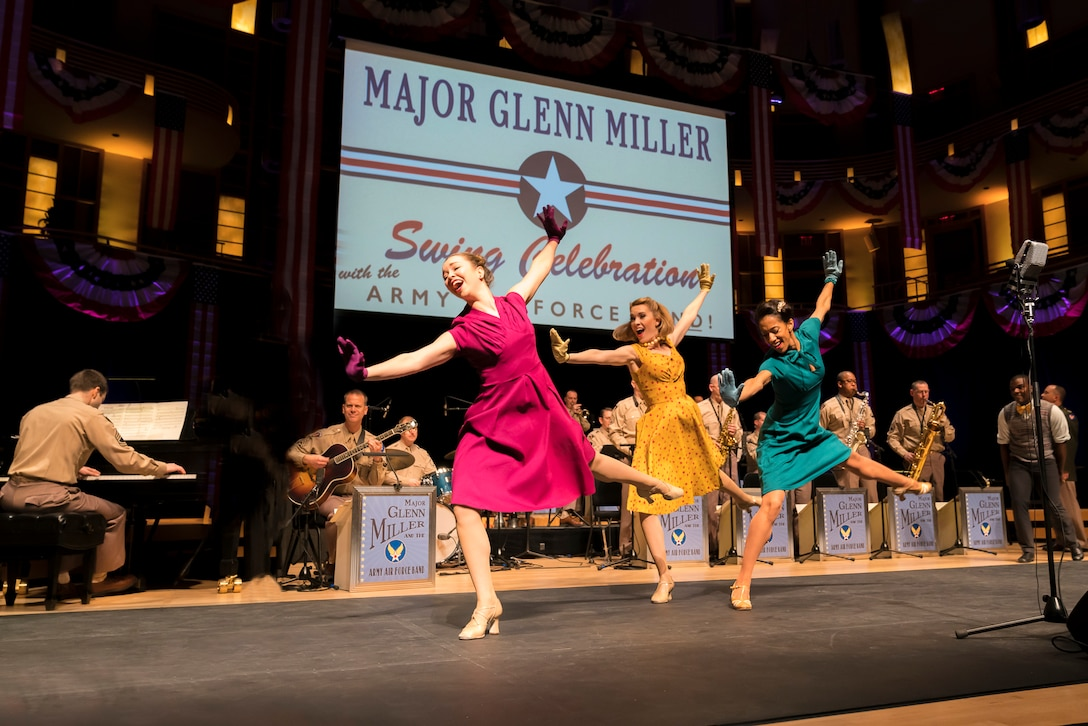 Members of The U.S. Air Force Band perform the music of big band legend Major Glenn Miller as professional dancers take center stage on April 2, 2019, at the Music Center at Strathmore in North Bethesda, Maryland. The U.S. Air Force Band partnered with Washington Performing Arts to present this concert highlighting the legacy of Major Miller's music and his leadership of the Army Air Force Band. This year marks the 75th anniversary of the disappearance of Miller's plane during World War II. (U.S. Air Force Photo by Master Sgt. Josh Kowalsky)