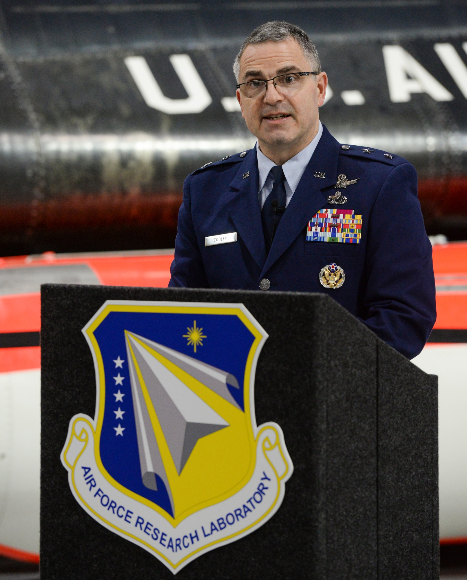 Maj. Gen. William T. Cooley, Air Force Research Laboratory commander, delivers remarks during a press conference inside the National Museum of the United States Air Force, Wright-Patterson Air Force Base, Ohio, April 18, 2019. Cooley spoke on AFRL's efforts to work with small businesses and universities in an effort to focus on speed when it comes to the science and technology strategy as unveiled by Secretary of the Air Force Heather Wilson. (U.S. Air Force photo by Wesley Farnsworth)