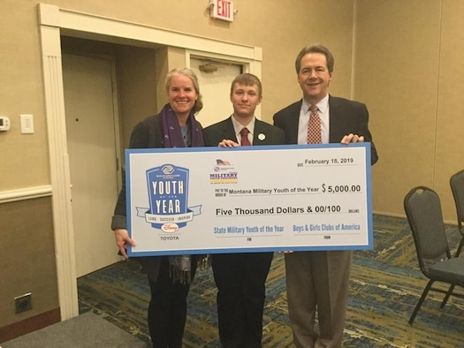 Anthony Harris, 2019 Montana State Military Youth of the Year, receives a college scholarship check from Mont. Gov. and Mrs. Steve Bullock.