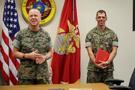 Maj. James R. Smith receives a Meritorious Service Medal for his dedication and selfless service at U.S. Marine Corps Forces, South, April 11, 2019.