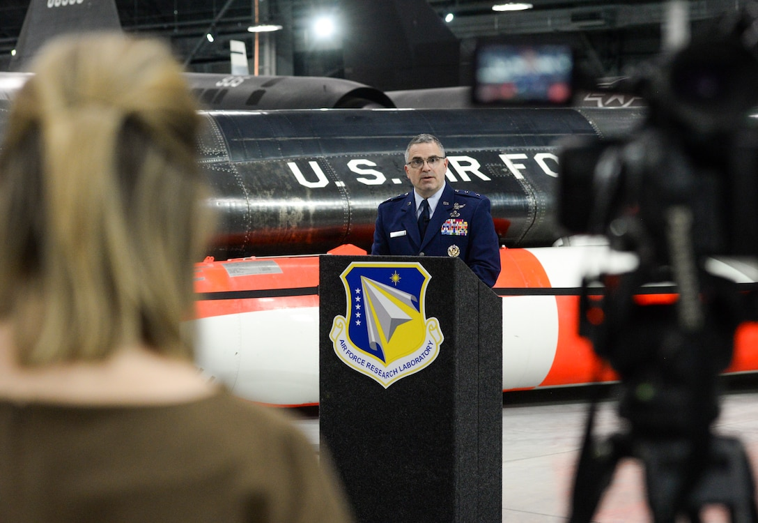 A member of the local media records U.S. Air Force Maj. Gen. William T. Cooley, Air Force Research Laboratory commander, as he delivers remarks during a press conference inside the National Museum of the United States Air Force, Wright-Patterson Air Force Base, Ohio, April 18, 2019. Cooley spoke on AFRL's efforts to work with small businesses and universities in an effort to focus on speed when it comes to the science and technology strategy as unveiled by Secretary of the Air Force Heather Wilson. (U.S. Air Force photo by Wesley Farnsworth)