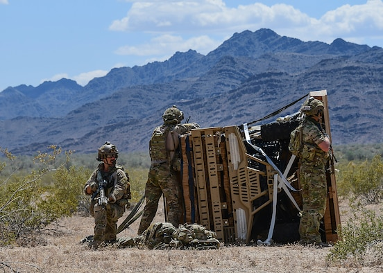 U.S. Air Force pararescuemen assigned to the 48th Rescue Squadron at Davis-Monthan Air Force Base, Ariz., conduct exercise scenarios during Razor's Edge, a two-week long pre-deployment exercise, at Parker, Ariz., April 12, 2019. Practicing real-world scenarios helps pararescuemen execute their core function of personnel recovery in austere environments downrange. (U.S. Air Force photo by Airman 1st Class Kristine Legate)