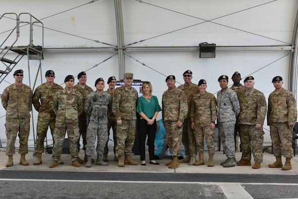 Brig Gen Doug Schiess, 45th Space Wing commander, his wife, Debbie, and 45th Security Forces Squadron Airmen pose for a photo at Patrick Air Force Base, Fla., April 16, 2019. Schiess visited the 45th SFS to learn about new capabilities and to be immersed in the Security Forces mission. (U.S. Air Force photo by Airman 1st Class Dalton Williams)