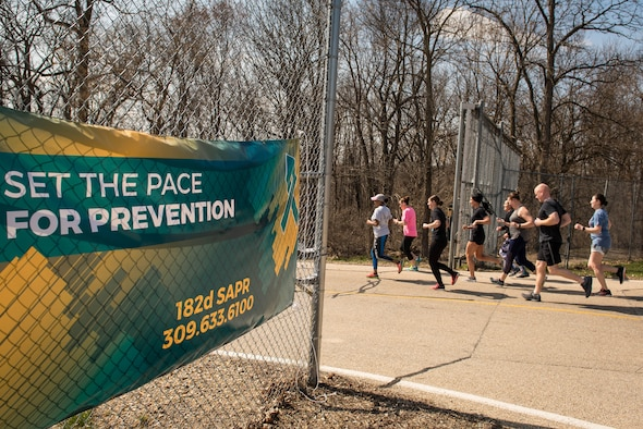 Airmen participate in a Sexual Assault Awareness run.