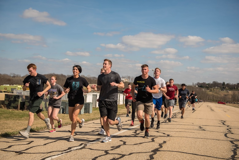 Airmen participate in a Sexual Assault Awareness run.