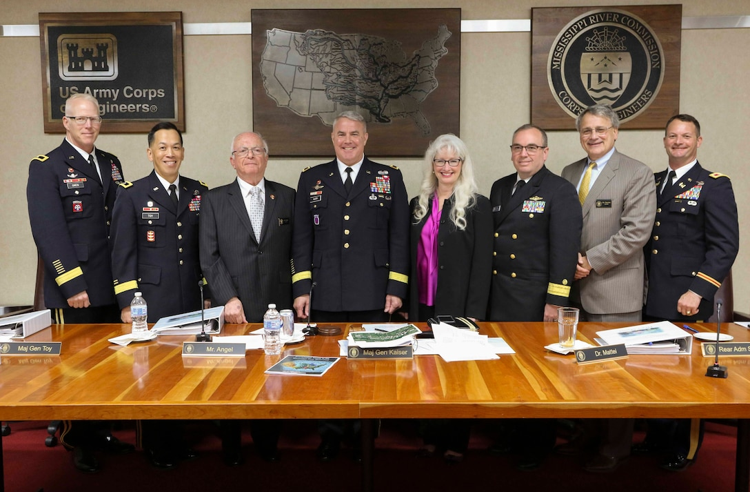 Mississippi River Commission members, Brig. Gen. Paul E. Owen, U.S. Army Corps of Engineers Southwestern Division commander; Maj. Gen. Mark Toy USACE Great Lakes and Ohio River Division commander; Hon. Sam E. Angel, civilian member, Maj. Gen. Richard G. Kaiser, MRC president; Hon. Norma Jean Mattei, Ph.D., civilian member/civil engineer; Rear Adm. Shepard Smith, with the National Oceanic and Atmospheric Administration; Hon. James A. Reeder, civilian member/civil engineer; and Col. Robert A. Hilliard, MRC secretary, stand aboard the MV Mississippi in Memphis, Tenn., April 9, 2019.