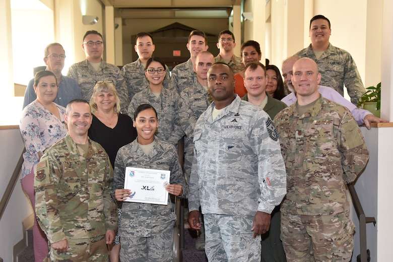 "Airman 1st Class Arial Taylor, a 47th Comptroller Squadron commander support staff administration journeyman, was chosen by wing leadership to be the ""XLer"" of the week, for the week of April 17, 2019, at Laughlin Air Force Base, Texas. The ""XLer"" award, presented by Col. Lee Gentile, 47th Flying Training Wing commander, is given to those who consistently make outstanding contributions to their unit and the Laughlin mission. (U.S. Air Force photo by Senior Airman John A. Crawford)"