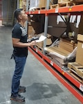 Josh P. Ramones, Inventory Action Team supply technician, inventories warehouse stock at DLA Distribution Pearl Harbor, Hawaii.