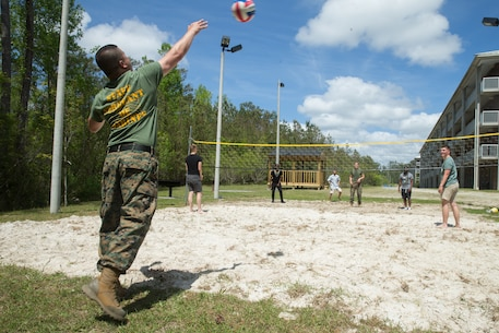 U.S. Marines with Combat Logistics Regiment 27, 2nd Marine Logistics Group, play volleyball during a barracks bash on Camp Lejeune, North Carolina, April 18, 2019. The purpose of the barracks bash was to celebrate completed barracks renovations, strengthen cohesion, foster a positive atmosphere and enhance the quality of life for Marines and Sailors. (U.S. Marine Corps photo by Cpl. Damion Hatch Jr)