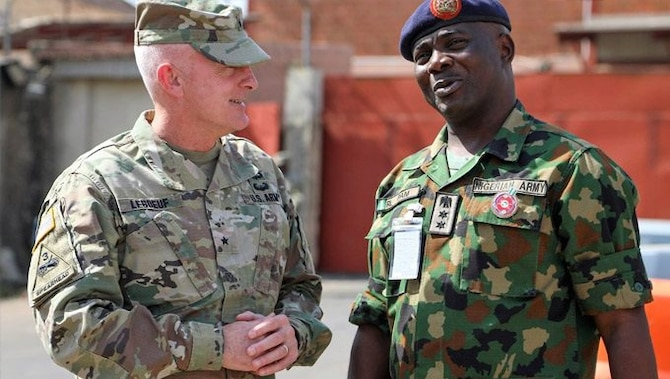 American and African Military Officers having a conversation.