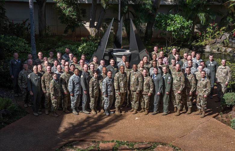 Commanders, Command Chiefs and Directors from across the Pacific Air Forces area of responsibility pose for a photo in the Courtyard of Heroes during the spring commander's conference at Joint Base Pearl Harbor-Hickam, Hawaii, 18 April 2019. The commander's conference gave attendees the chance to discuss challenges and opportunities to succeed in an era of great power competition. (U.S. Air Force Photo by Staff Sgt. Hailey Haux)