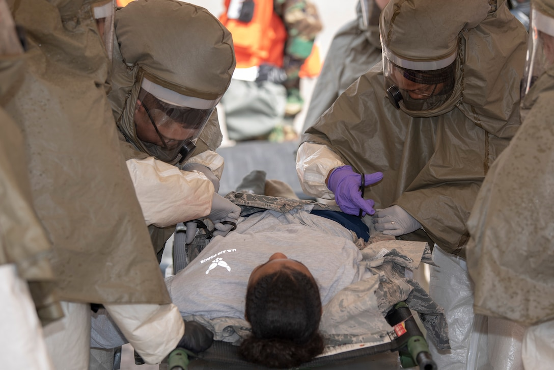 U.S. Air Force 52nd Medical Group personnel perform decontamination procedures on a mock victim during a week-long base readiness exercise at Spangdahlem Air Base, Germany, April 17, 2019. Exercise victims are decontaminated and moved to the medical building for more hands-on treatment. (U.S. Air Force photo by Airman 1st Class Branden Rae)