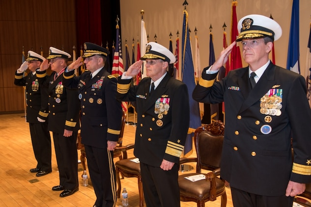 190425-N-TB148-0052 BUSAN, Republic of Korea (April 25, 2019) The official party (from left): Cmdr. Santiago Rodriguez, command chaplain assigned to Commander, U.S. Naval Forces Korea (CNFK); Rear Adm. Michael E. Boyle, commander, CNFK; U.S. Army Gen. Robert B. Abrams, commander, U.S. Forces Korea; Vice Adm. Phillip Sawyer, commander, U.S. 7th Fleet; and Rear Adm. Michael P. Donnelly render a salute during a change of command ceremony at (CNFK) headquarters. During the ceremony, Donnelly relieved Boyle to become CNFK's 37th commander.