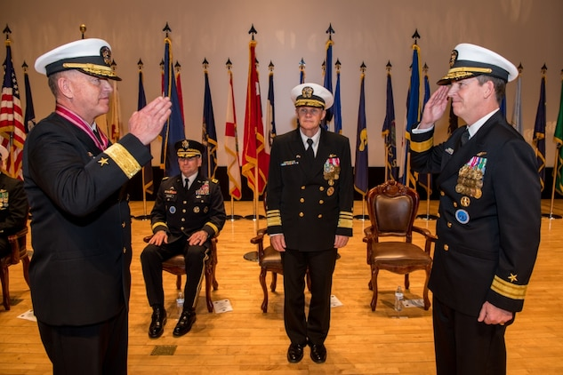 190425-N-TB148-0125 BUSAN, Republic of Korea (April 25, 2019) Rear Adm. Michael P. Donnelly renders a salute to Vice Adm. Phil J. Sawyer, commander, U.S. 7th Fleet, during a change of command ceremony aboard the Republic of Korea (ROK) Fleet base in Busan. Donnelly relieved Rear Adm. Michael E. Boyle to become the 37th commander of U.S. Naval Forces Korea.