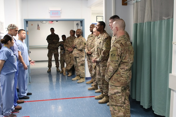 Intensive Care Unit staff at Craig Joint Theater Hospital give an overview of services and protocols to members of the USACE Afghanistan District and the Command Sergeant Major of USACE Brad Houston as they continue their tour of the Path of the Patient.
