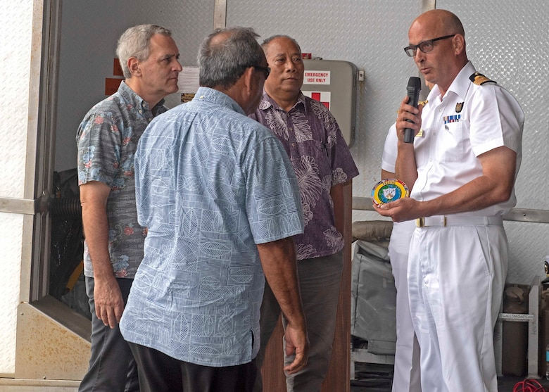 CHUUK, Federated States of Micronesia (April 25, 2019) Royal Navy Capt. Paddy Allen, director of mission, presents His Excellency President Peter Christian, president of the Federated States of Micronesia, with a Pacific Partnership medallion at the closing ceremony aboard the Military Sealift Command expeditionary fast transport ship USNS Brunswick (T-EPF 6), strengthening strategic partnerships during Pacific Partnership 2019. Pacific Partnership, now in its 14th iteration, is the largest annual multinational humanitarian assistance and disaster relief preparedness mission conducted in the Indo-Pacific.