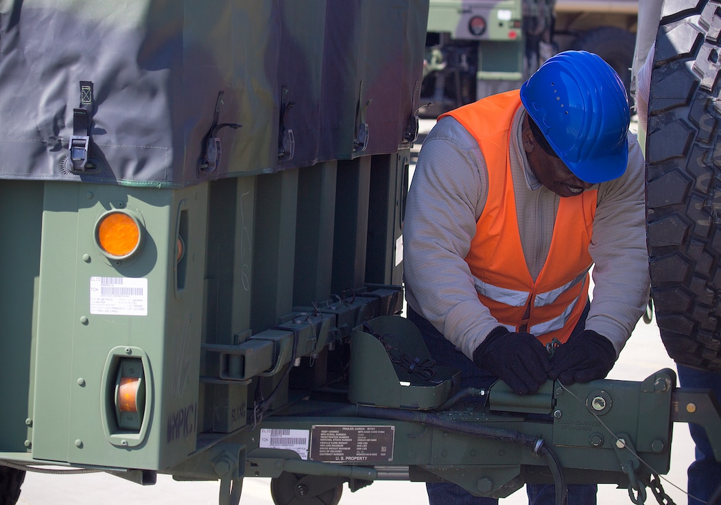 David Gaddy, Quality Assurance Specialist, Army Field Support Battalion-Mannheim examines a trailer as part of the battalion's quality assurance process at Coleman Work Site, Germany, April 4.