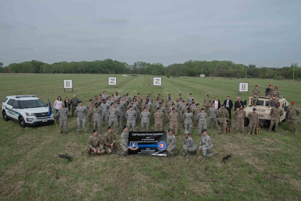The 22nd Security Forces Squadron poses for a photoApril 24, 2019, at McConnell Air Force Base, Kan. The 22nd SFS achieved the Best Medium Unit Award in not only the Air Mobility Command, but also the Air Force. (U.S. Air Force photo by Airman 1st Class Alan Ricker)