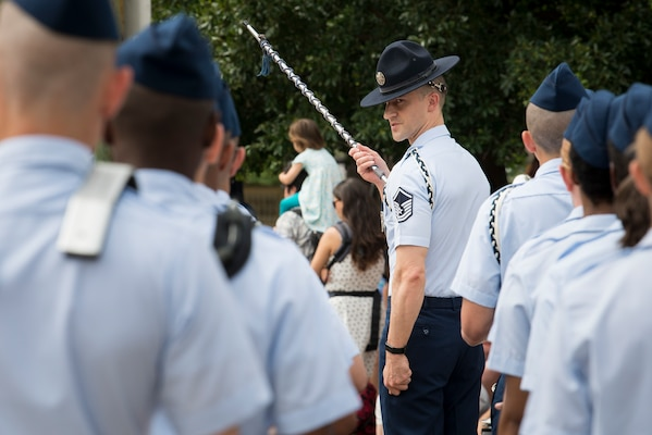 Master Sgt. Douglas Kost, 321st Training Squadron military training instructor, marches the Joint Base San Antonio-Lackland Drum and Bugle Corps after performing during San Antonio's Fiesta Air Force Day at the Alamo, April 22, 2019. From its beginning in 1891, Fiesta has grown into an annual celebration that includes civic and military observances, street and river parades, exhibits, pilgrimages and memorials.