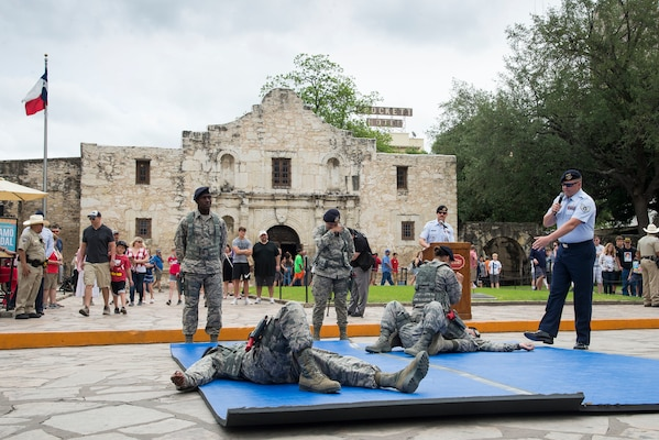 Members of the 343rd Training Squadron, perform apprehension techniques during San Antonio's Fiesta Air Force Day at the Alamo, April 22, 2019. From its beginning in 1891, Fiesta has grown into an annual celebration that includes civic and military observances, street and river parades, exhibits, pilgrimages and memorials.
