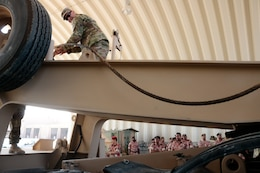 U.S. Army Staff Sgt. Andrew Jones feeds a winch cable while demonstrating to Royal Army of Oman Soldiers how to correct a malfunction during the Heavy Equipment Transporter System Subject Matter Exchange II held at Sultan bin Safy Camp Shafa Oman, April 6-11, 2019.