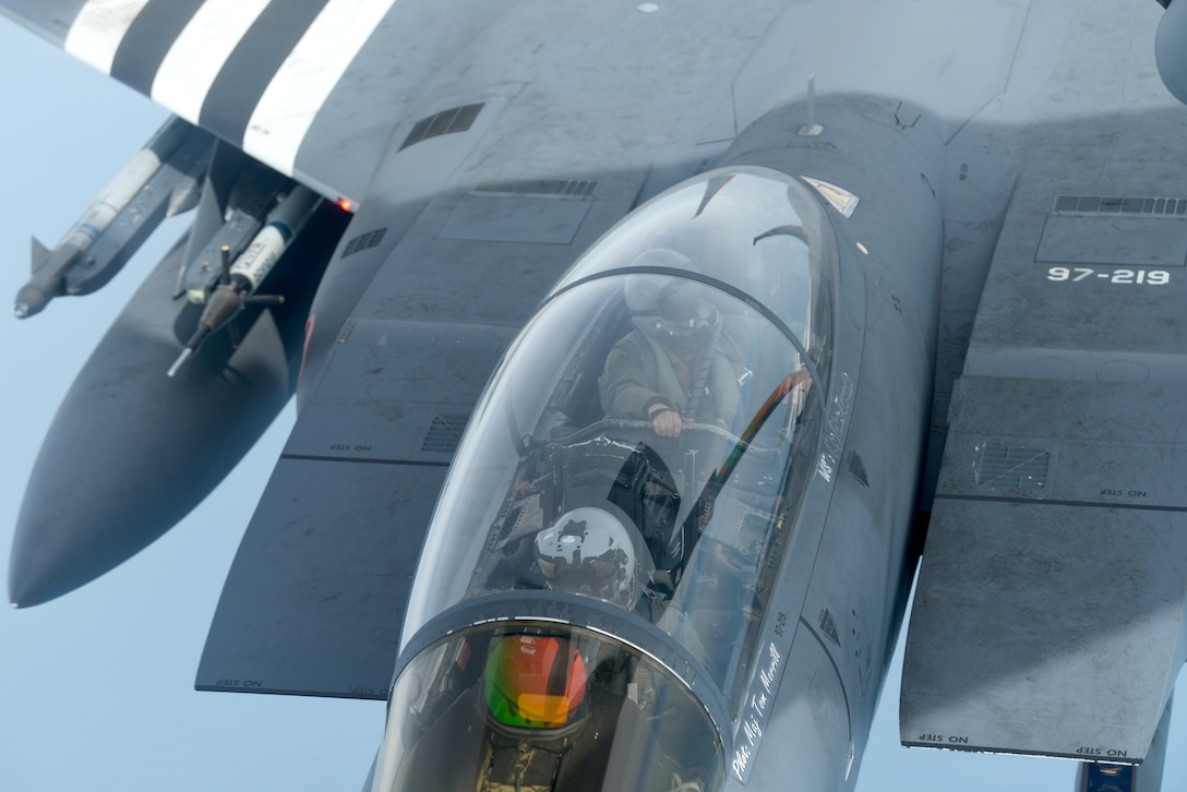 "An F-15E Strike Eagle assigned to the 48th Fighter Wing at RAF Lakenheath, England, painted in the heritage colors of its World War II P-47 Thunderbolt predecessor, receives fuel from a 351st Air Refueling Squadron KC-135 Stratotanker at RAF Mildenhall during the ""FURIOUS 48"" readiness exercise over the skies of England, April 24, 2019. The exercise was designed to emphasize the importance of combat skills effectiveness training and test 100th ARW and 48th FW Airmen on their ability to survive and operate in wartime conditions. (U.S. Air Force photo by Airman 1st Class Brandon Esau)"