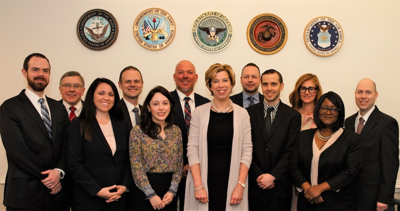 The Honorable Ellen M. Lord smiles for a photo with DOD Public-Private Talent Exchange program participants.