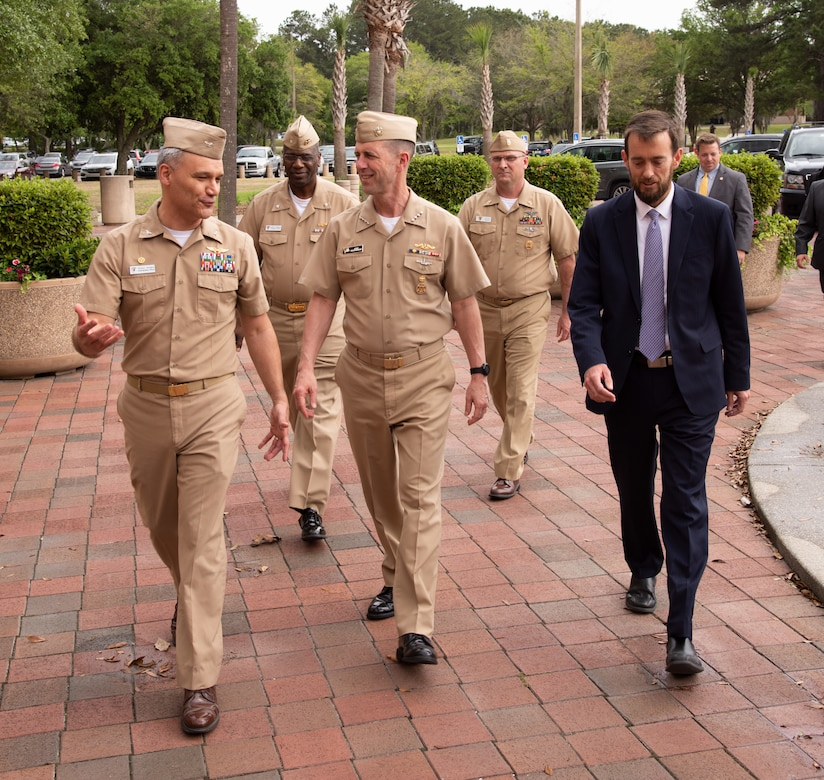 Naval Information Warfare Center Atlantic Commanding Officer Capt. Wesley Sanders, left, chats with Chief of Naval Operations Adm. John Richardson, center, as the CNO and NIWC Atlantic leadership team walk to the main engineering center.