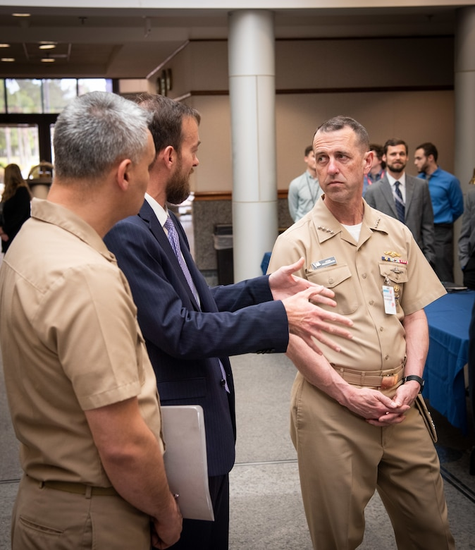 Naval Information Warfare Center Atlantic Executive Officer Christopher Miller talks with Chief of Naval Operations Adm. John Richardson during the CNO's visit.