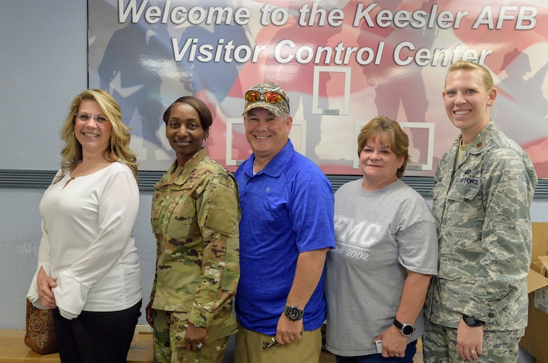 "81st Force Support Squadron leadership and an Airman and Family Readiness Center representative pose for a photo with Air Force Family Forever Members Michael and Donna ""Denise"" Bradford, parents of Airman 1st Class Brian Bradford, inside the visitor center at Keesler Air Force Base, Mississippi, Apr. 23, 2019.  As surviving parents of a service member, Michael and Donna obtained an ID card for recognition and installation access so they can attend events and access A&FRC referral services. (U.S. Air Force Photo by Andre' Askew)"