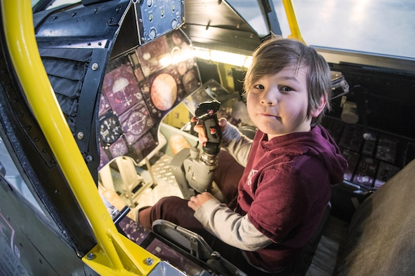 DAYTON, Ohio - A museum visitor enjoying the A-7D Sit-in Cockpit in the Cold War Gallery at the National Museum of the U.S. Air Force. (U.S. Air Force photo)