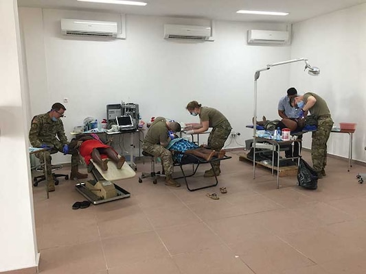 U.S. Army dentists Lt. Col. Eric Unkenholz, Col. Murray Thompson, and Maj. Kevin Donlin and Staff Sgt. Samantha Wempe, dental technician, all with the South Dakota National Guard, perform dental work and tooth extractions on adults and children in Albina, Suriname, April 10, 2019. A SDARNG medical/dental team partnered with Suriname military and civilian medical personnel to assist with ongoing efforts of improving systemic and oral health in the region.