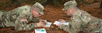 """Soldiers assigned to Eisenhower Army Medical Center take a break from their hospital duties to hone their land navigation skills through regular training exercises designed to keep their """"soldier"""" skills sharp."""