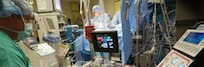 Members of Eisenhower Army Medical Center's surgical team perform open heart surgery.