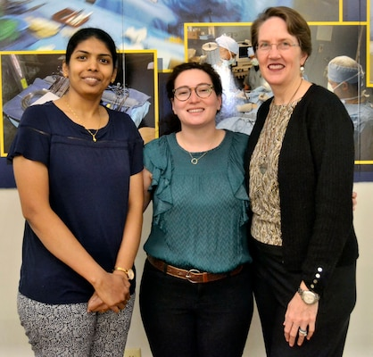 Padmabharathi Pothirajan, a Medical biomedical engineer, left, Danielle Gerstman, a Medical biomedical engineer, center, and Denise Scobee, a Medical biomedical engineer, right, pose for a photo at DLA Troop Support March 24, 2019 in Philadelphia.