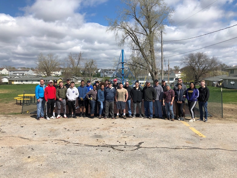 Members of the 55th Communications Group stand for a photo April 2019, at Peter Sarpy Elementary School, Bellevue. The school was in dire need of a new playground. (U.S. Air Force courtesy photo)