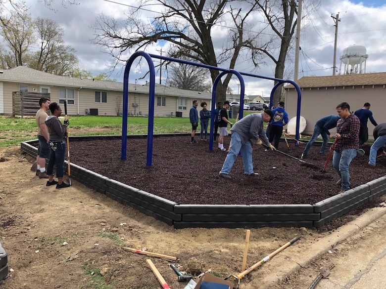 Members of the 55th Communications Group rake mulch April 2019, at Peter Sarpy Elementary School, Bellevue. The squadron volunteers helped install a new playground for the school. (U.S. Air Force courtesy photo)