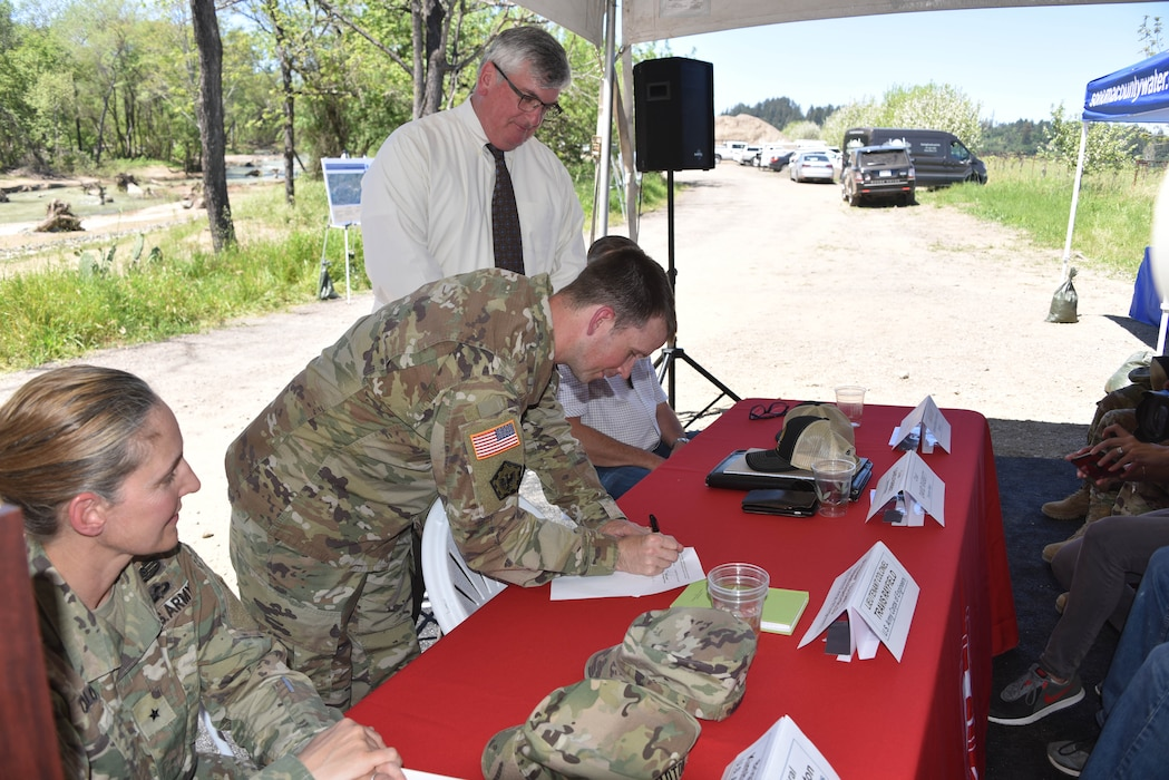 San Francisco District Commander LTC Travis Rayfield signs a design agreement for habitat restoration on a section of the Dry Creek near Healdsburg, Calif.