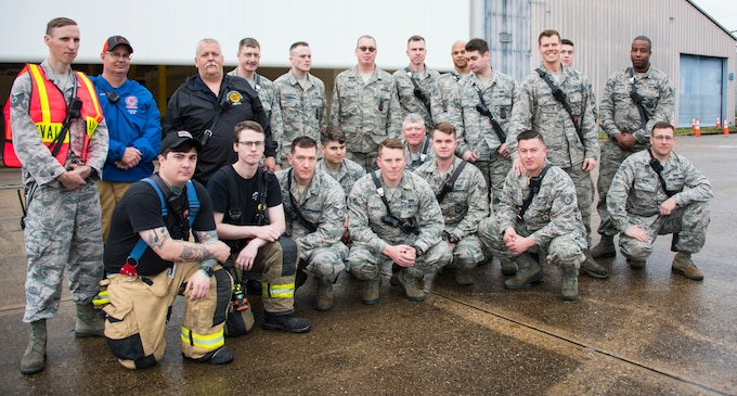 166th Civil Engineer Squadron firefighters pose for a group photo with Wilmington Manor Fire Company Director Bernie Nutter II prior to the start of Operation Blue Skywalker, April 10, 2019 at Delaware National Guard Base, Del. 166th CES firefighters worked in coordination with the Wilmington Manor Fire Company. (U.S. Air Force photo by Mr. Mitch Topal)