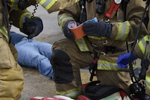 First responders from the 166th Civil Engineer Squadron firefighters apply a compression bandage to a crash victim during Operation Blue Skywalker, April 10, 2019 at Delaware National Guard Base, Del. 166th CES firefighters were first on scene at the mock disaster site. (U.S. Air Force photo by Mr. Mitch Topal)