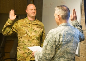 Maj. Kevin Eklund, 934th Airlift Wing director of inspections, is sworn in as a certified inspector of the 934th Airlift Wing by Col. Anthony Polashek, 934th Airlift Wing commander at Minneapolis-St. Paul Air Reserve Station, Minn., Apr. 18, 2019.